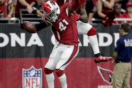 Arizona Cardinals defensive back Marcus Cooper (41) celebrates his touchdown after an interception with teammate cornerback Patrick Peterson (21) against the Tampa Bay Buccaneers during the second half of an NFL football game, Sunday, Sept. 18, 2016, in Glendale, Ariz. (AP Photo/Rick Scuteri)