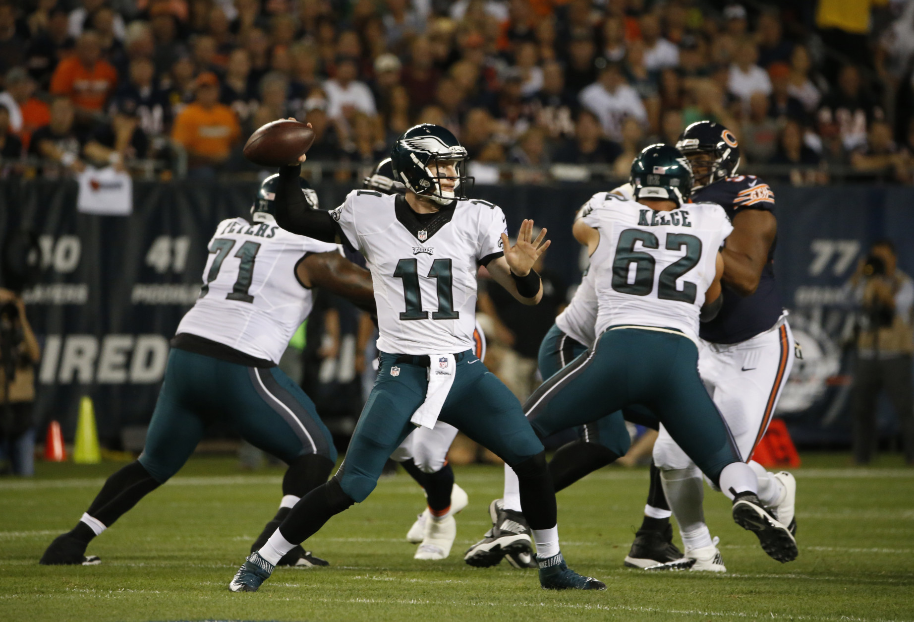 Philadelphia Eagles quarterback Carson Wentz (11) throws a pass during the first half of an NFL football game against the Chicago Bears, Monday, Sept. 19, 2016, in Chicago. (AP Photo/Nam Y. Huh)