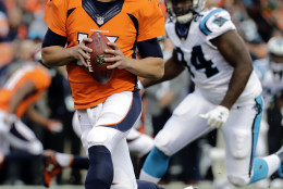 Denver Broncos quarterback Trevor Siemian (13) looks to pass as Carolina Panthers defensive end Kony Ealy (94) pursues during the first half of an NFL football game, Thursday, Sept. 8, 2016, in Denver. (AP Photo/Jack Dempsey)