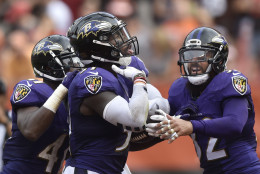 Baltimore Ravens inside linebacker C.J. Mosley (57) celebrates with strong safety Eric Weddle (32) after intercepting a pass in the fourth quarter of an NFL football game against the Cleveland Browns, Sunday, Sept. 18, 2016, in Cleveland. Baltimore won 25-20. (AP Photo/David Richard)