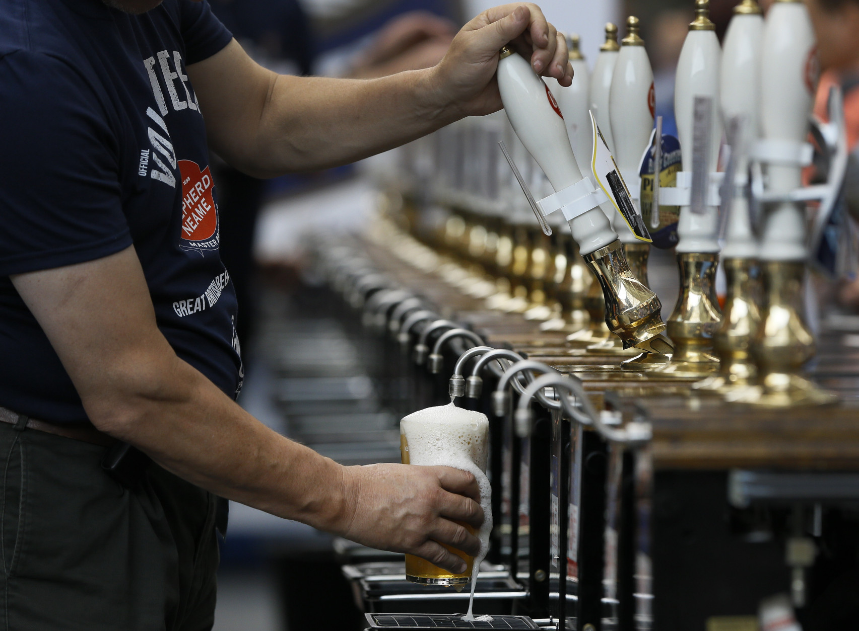 A pint of beer is poured at the Great British Beer Festival, at Olympia in London, Tuesday, Aug. 11, 2015. The five day event is organised by the Campaign for Real Ale (CAMRA), with over 900 real ales, ciders, perries and international beers on offer.  (AP Photo/Kirsty Wigglesworth)