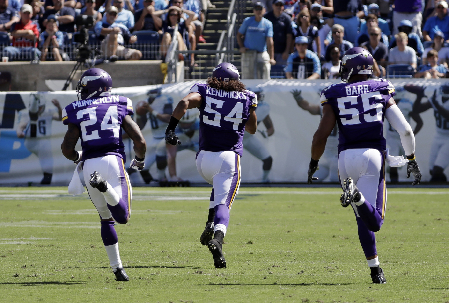 Minnesota Vikings linebacker Eric Kendricks (54) returns an intercepted pass 77 yards for a touchdown against the Tennessee Titans in the second half of an NFL football game Sunday, Sept. 11, 2016, in Nashville, Tenn. With Kendricks are Captain Munnerlyn (24) and Anthony Barr (55). (AP Photo/James Kenney)