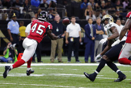 Atlanta Falcons outside linebacker Deion Jones (45) intercepts a pass from New Orleans Saints quarterback Drew Brees, not pictured, and returns it for a touchdown, in the second half of an NFL football game in New Orleans, Monday, Sept. 26, 2016. (AP Photo/Butch Dill)