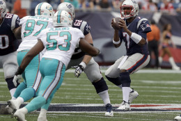 New England Patriots quarterback Jacoby Brissett (7) drops back to pass as Miami Dolphins defensive tackle Jordan Phillips (97) and linebacker Jelani Jenkins (53) rush during the first half of an NFL football game Sunday, Sept. 18, 2016, in Foxborough, Mass. (AP Photo/Charles Krupa)