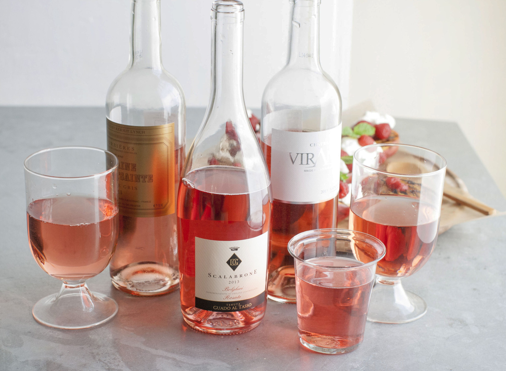 This June 2, 2014 photo shows from left to right, Domaine De Fontsainte, Scalabrone and Chateau Viranel rose wines in Concord, N.H. (AP Photo/Matthew Mead)
