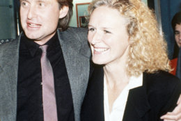 "Actor Michael Douglas and actress Glenn Close pose outside the Loew's Theater in New York, USA on Sept. 17, 1987 after viewing the premier of their new movie ""Fatal Attraction."" (AP Photo/Frankie Ziths)"