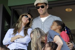 New England Patriots quarterback Tom Brady and his wife, Giselle, left, stand in a box during a baseball game between the Boston Red Sox and the New York Yankees at Fenway Park in Boston, Friday, April 20, 2012. (AP Photo/Elise Amendola)