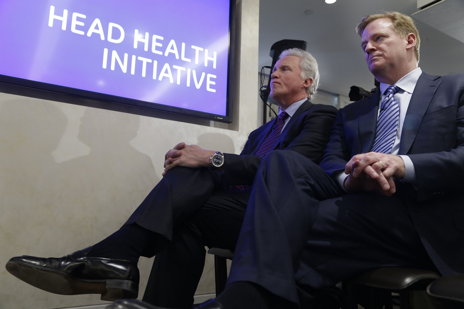 "FILE - In this March 11, 2013, file photo, Chairman and CEO of General Electric, Jeff Immelt, left, and NFL Commissioner Roger Goodell listen during a news conference in New York, about GE partnering with the NFL, the US Military, and others to further research on head injuries. Commissioner Goodell enters his second decade in charge on Thursday, Sept. 1, 2016. A few years into Goodell's tenure as NFL commissioner, a grad school professor polled students on who was the most effective leader in the major sports. Goodell romped.  That was before the league locked out the players in 2011. Before the Saints' bounties scandal. Before the behavior of Ray Rice and Adrian Peterson _ and so many others _ led to a stricter player conduct policy.  Before game officials were locked out. Before Tom Brady's suspension in ""Deflategate."" And before issues over head trauma and concussions brought player safety questions to the forefront.  (AP Photo/Seth Wenig, File)"