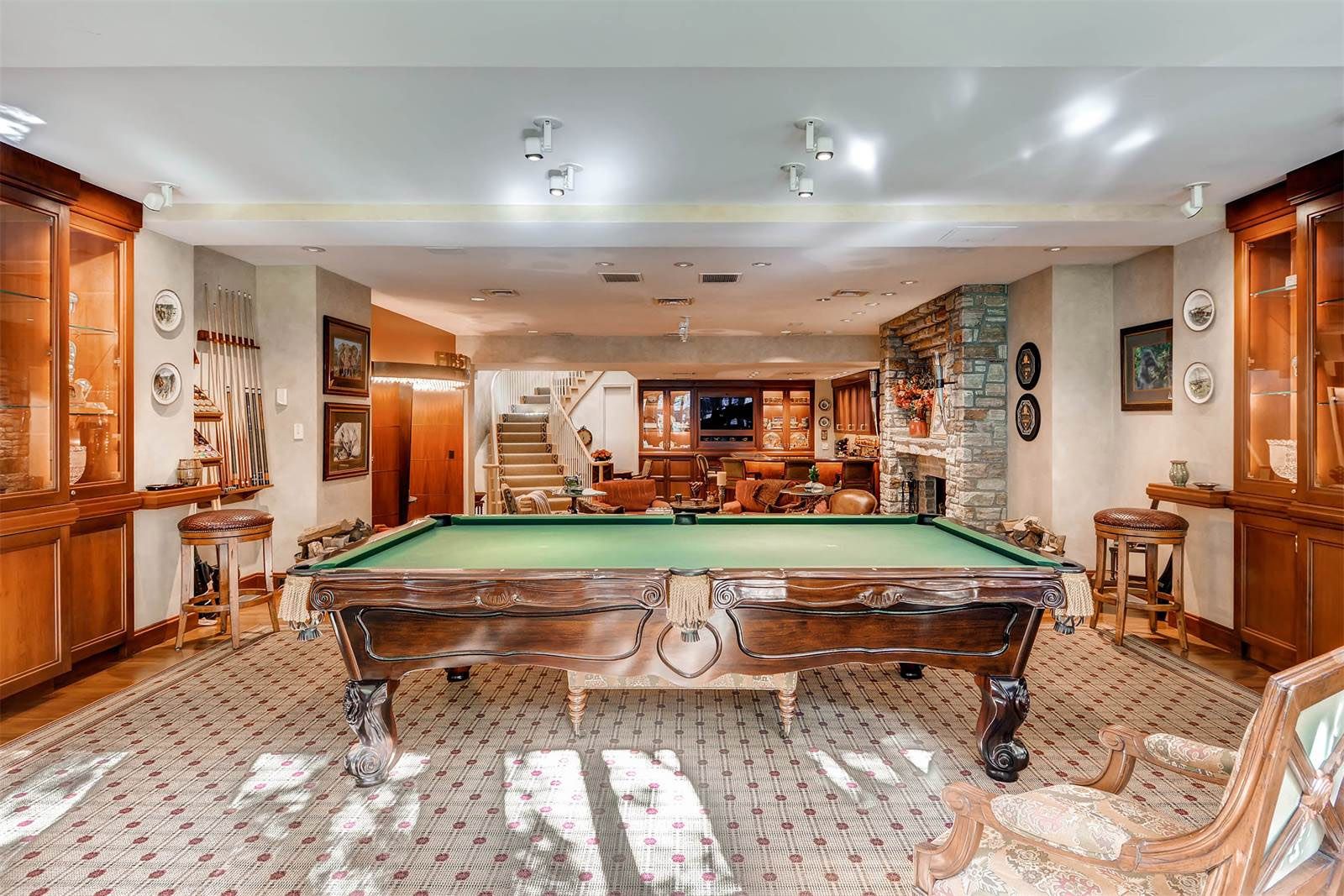 The home features a finished basement, home theater, six bedrooms and multiple fireplaces. (Courtesy Monument Sotheby's International Realty)
