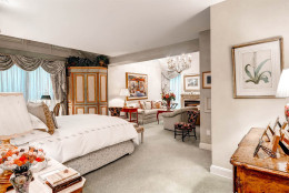 The estate features six bedrooms. The master bedroom has a gas fireplace. (Courtesy Monument Sotheby's International Realty)