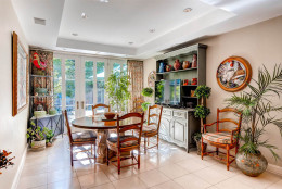 The estate features a separate breaksfast room and a formal dining room. (Courtesy Monument Sotheby's International Realty)