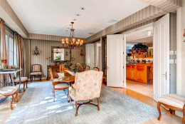 The formal dining room has hardwood floors and sits off the gourmet kitchen. (Courtesy Monument Sotheby's International Realty)