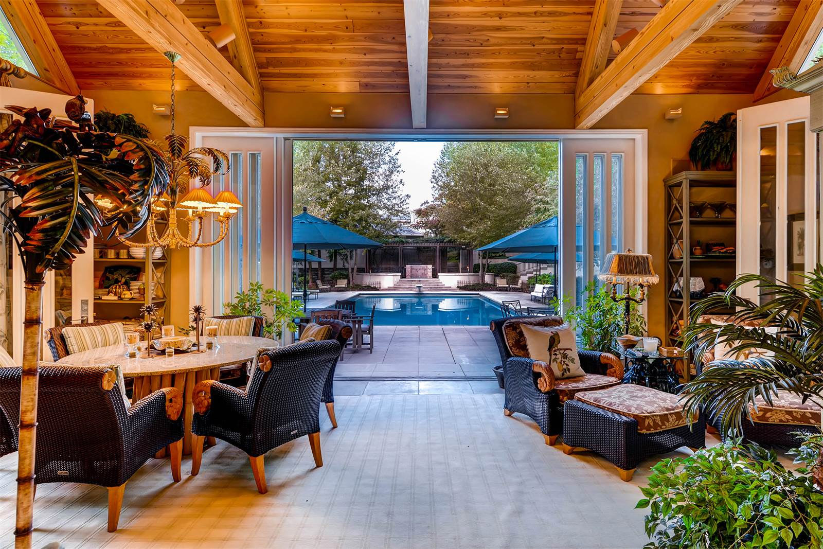 The 25-acre secluded estate comes with a pool, cabana, game room, indoor basketball court and batting cage. (Courtesy Monument Sotheby's International Realty)