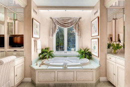 The main home has 10 full bathrooms. (Courtesy Monument Sotheby's International Realty)