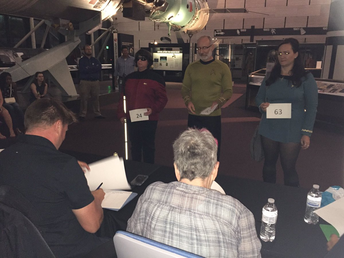 The judges evaluate the contestants of the Star Trek costume contest at the National Air and Space Museum. (WTOP/Michelle Basch)