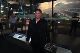 Rod Roddenberry in front of the StarTrek Starship Enterprise studio model at the National Air and Space Museum. (WTOP/Michelle Basch)