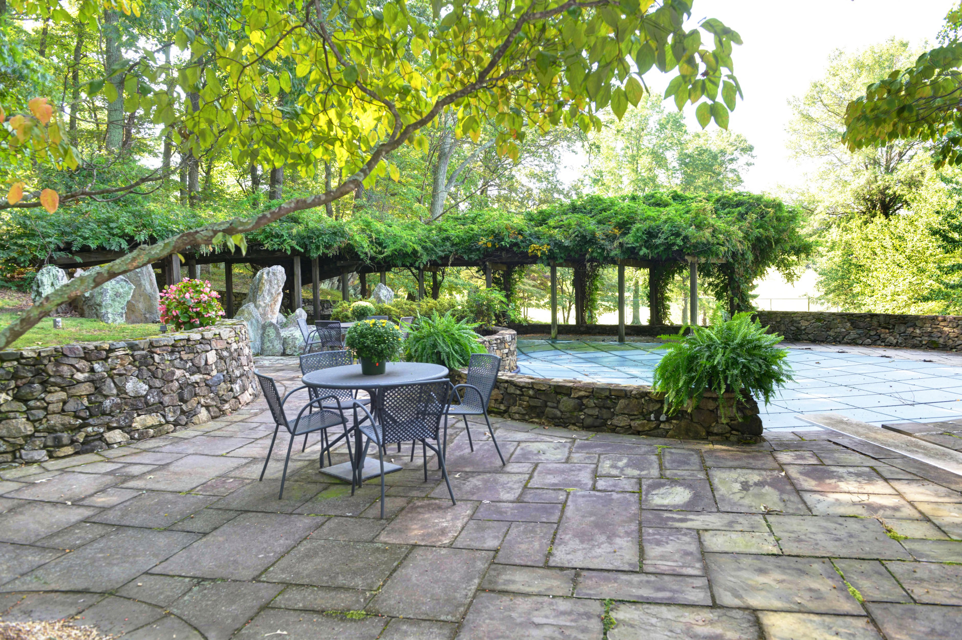 This photo provided by Thomas and Talbot Real Estate shows a patio at the Wexford Estate, the 1963 retreat that Jacqueline Kennedy Onassis designed for her family. The home is nestled on more than 166 acres in Virginia's hunt country.  (Courtesy Thomas and Talbot Real Estate and Mona Botwick Photography)