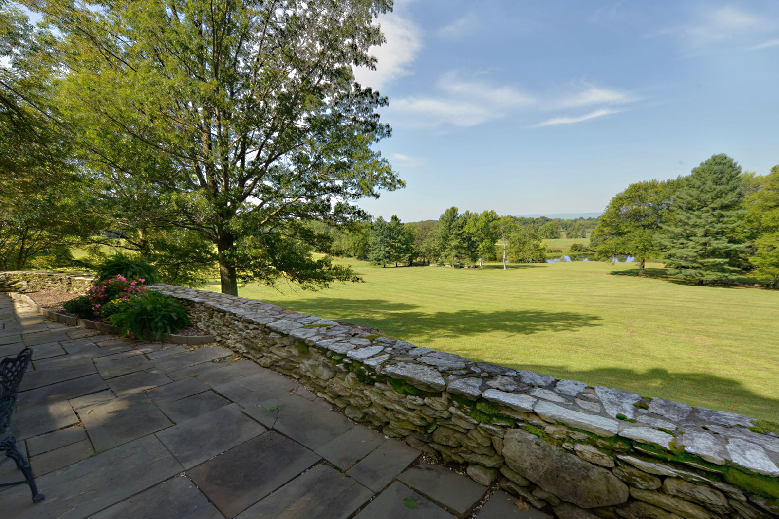 This photo provided by Thomas and Talbot Real Estate shows a  large pond that lies on the more than 166-acres Wexford Estate in Marshall, Virginia. Nestled on the property is the 1963 retreat that Jacqueline Kennedy Onassis designed for her family. The property is selling for $5.9 million. (Courtesy Thomas and Talbot Real Estate and Mona Botwick Photography)