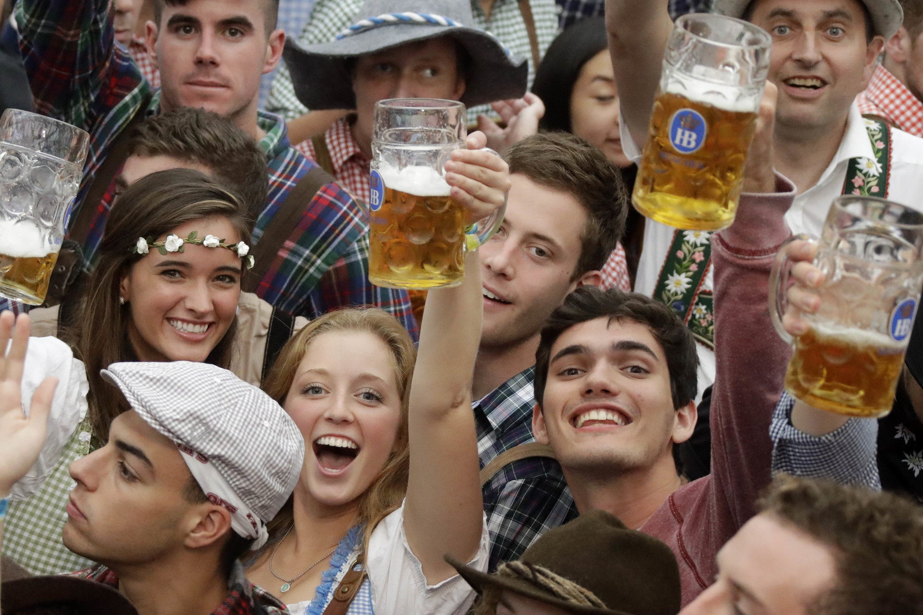 Young people celebrate the opening of the 183rd Oktoberfest beer festival in Munich, southern Germany, Saturday, Sept. 17, 2016. The world's largest beer festival will be held from Sept. 17 to Oct. 3, 2016. (AP Photo/Matthias Schrader)