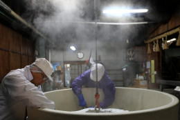 HIMEJI, JAPAN - JANUARY 24:  Japanese sake brewery workers prepare to remove freshly steamed rice in preparation for making sake at Tanaka Sake Brewery on January 24, 2014 in Himeji, Japan. Japanese Prime Minister Shinzo Abe targets 60 billion yen by 2020, a fivefold increase in rice-based product exports including sake.  (Photo by Buddhika Weerasinghe/Getty Images).  (Photo by Buddhika Weerasinghe/Getty Images)