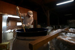 HIMEJI, JAPAN - JANUARY 24:  A Japanese sake brewery worker stirs fermenting sake at Tanaka Sake Brewery on January 24, 2014 in Himeji, Japan. Japanese Prime Minister Shinzo Abe targets 60 billion yen by 2020, a fivefold increase in rice-based product exports including sake.  (Photo by Buddhika Weerasinghe/Getty Images).  (Photo by Buddhika Weerasinghe/Getty Images)