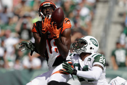EAST RUTHERFORD, NJ - SEPTEMBER 11:   A.J. Green #18 of the Cincinnati Bengals catches a touchdown over Darrelle Revis #24 of the New York Jets during their game at MetLife Stadium on September 11, 2016 in East Rutherford, New Jersey.  (Photo by Streeter Lecka/Getty Images)