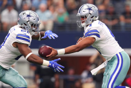 ARLINGTON, TX - SEPTEMBER 11:  Dak Prescott #4 hands the ball to Ezekiel Elliott #21 of the Dallas Cowboys during the first quarter against the New York Giants at AT&T Stadium on September 11, 2016 in Arlington, Texas.  (Photo by Tom Pennington/Getty Images)
