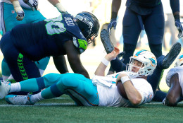 SEATTLE, WA - SEPTEMBER 11:  Quarterback Ryan Tannehill #17 of the Miami Dolphins scores a touchdown against the Seattle Seahawks in the fourth quarter at CenturyLink Field on September 11, 2016 in Seattle, Washington.  (Photo by Otto Greule Jr/Getty Images)