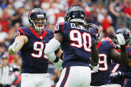 HOUSTON, TX - SEPTEMBER 18:  J.J. Watt #99 and  Jadeveon Clowney #90 of the Houston Texans celebrate a play in the first quarter of their game against the Kansas City Chiefs at NRG Stadium on September 18, 2016 in Houston, Texas.  (Photo by Scott Halleran/Getty Images)