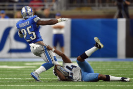 DETROIT, MI - SEPTEMBER 18:  Theo Riddick #25 of the Detroit Lions is brought down by Daimion Stafford #24 of the Tennessee Titans during a game at Ford Field on September 18, 2016 in Detroit, Michigan.  (Photo by Stacy Revere/Getty Images)