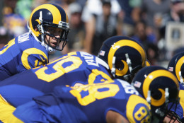 LOS ANGELES, CA - SEPTEMBER 18:  Quarterback Case Keenum #17 of the Los Angeles Rams calls signals to teammates during the second quarter of the home opening NFL game against the Seattle Seahawks at Los Angeles Coliseum on September 18, 2016 in Los Angeles, California.  (Photo by Jeff Gross/Getty Images)