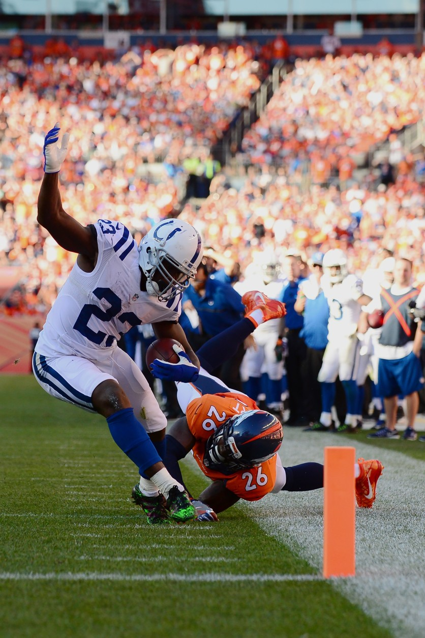 DENVER, CO - SEPTEMBER 18:  Running back Frank Gore #23 of the Indianapolis Colts shrugs off free safety Darian Stewart #26 of the Denver Broncos to score a touchdown in the fourth quarter of the game at Sports Authority Field at Mile High on September 18, 2016 in Denver, Colorado. (Photo by Dustin Bradford/Getty Images)