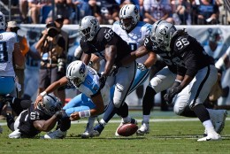 NASHVILLE, TN - SEPTEMBER 25:  Bruce Irvin #51 of the Oakland Raiders causes quarterback Marcus Mariota #8 of the Tennessee Titans to fumble during the first half at Nissan Stadium on September 25, 2016 in Nashville, Tennessee.  (Photo by Frederick Breedon/Getty Images)