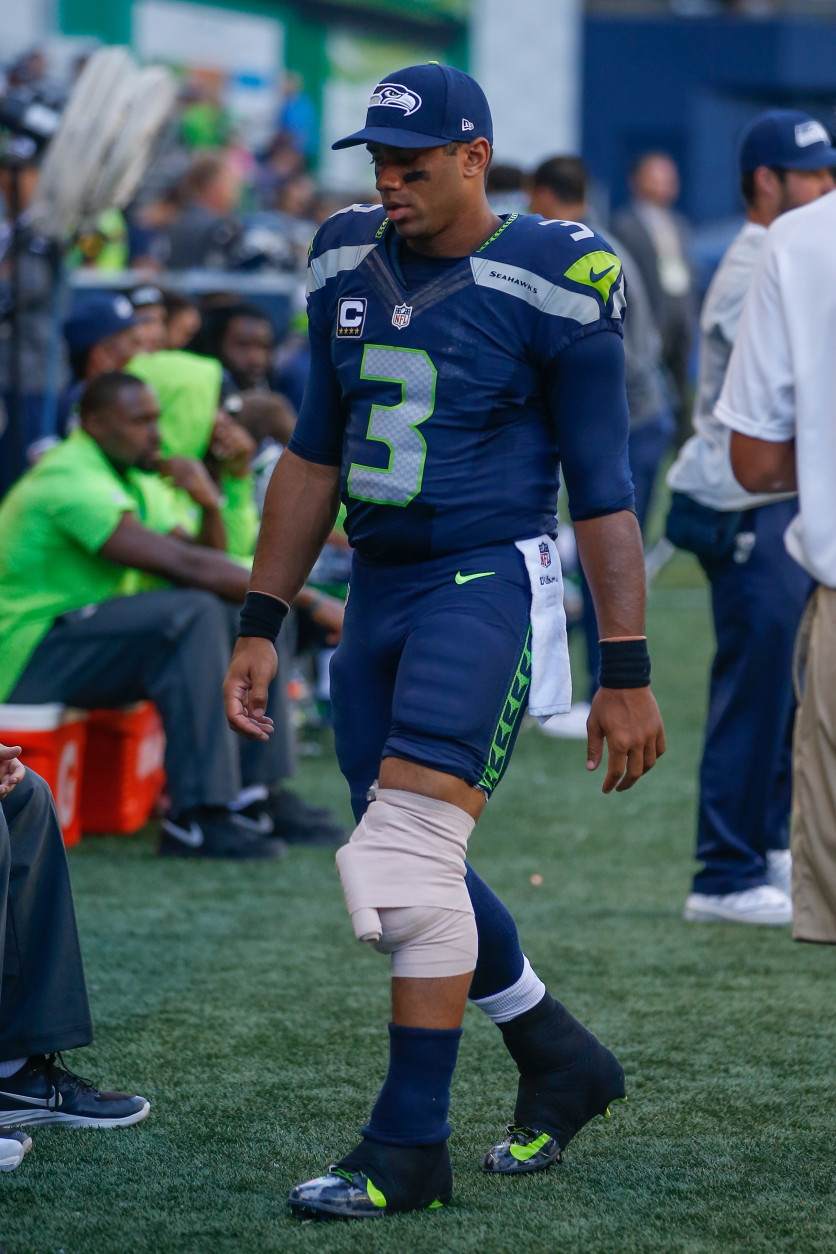 SEATTLE, WA - SEPTEMBER 25:  Quarterback Russell Wilson #3 of the Seattle Seahawks walks on the sidelines with his knee wrapped after coming out of the game in the second half against the San Francisco 49ers at CenturyLink Field on September 25, 2016 in Seattle, Washington.  (Photo by Otto Greule Jr/Getty Images)