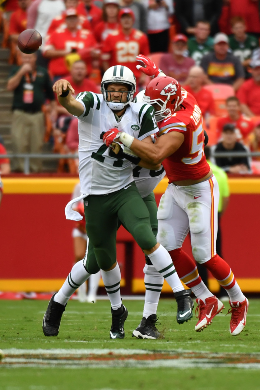KANSAS CITY, MO - SEPTEMBER 25: Quarterback Ryan Fitzpatrick #14 of the New York Jets tries to throw a pass during the tackle attempt of outside linebacker Frank Zombo #51 of the Kansas City Chiefs at Arrowhead Stadium during the second quarter of the game on September 25, 2016 in Kansas City, Missouri. (Photo by Peter Aiken/Getty Images)