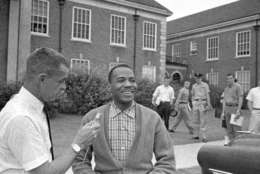 African American James H. Meredith grins as he answers a question at an impromptu conference between classes at the University of Mississippi in Oxford, Miss., on Oct. 11, 1962. Meredith, who integrated Ole Miss, walked from class to class this morning alone. Students gathered in small groups but were silent. (AP Photo/Jim Bourdier)