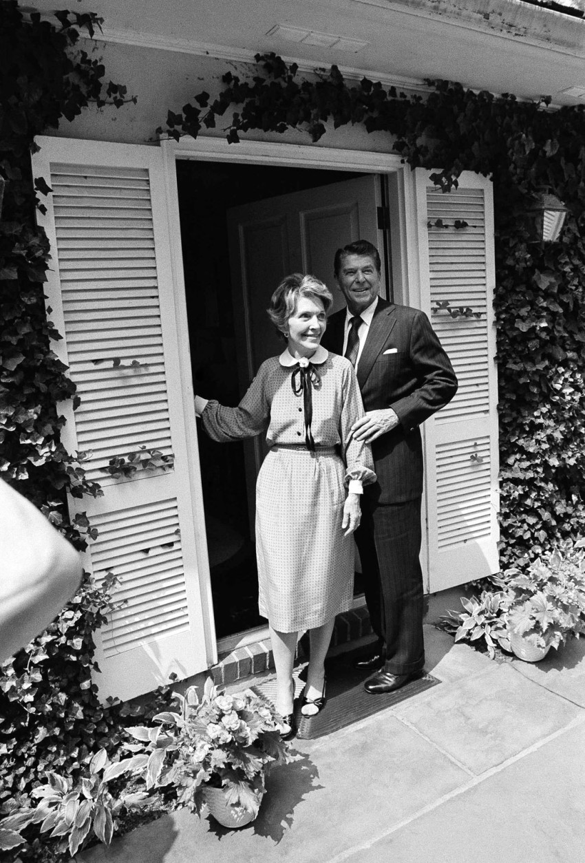 Republican presidential nominee Ronald Reagan and wife Nancy speak to reporters from the front door of their rented estate, Wexford, near Middleburg, Virginia after arriving, Thursday, August 29, 1980. The Reagan's will use the home as a retreat during the political campaign. (AP Photo)