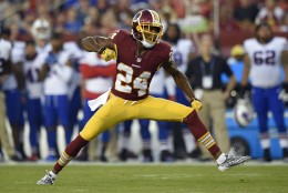 Washington Redskins defensive back Josh Norman (24) reacts after a play during the first half of an NFL preseason football game against the Buffalo Bills, Friday, Aug. 26, 2016, in Landover, Md. (AP Photo/Nick Wass)