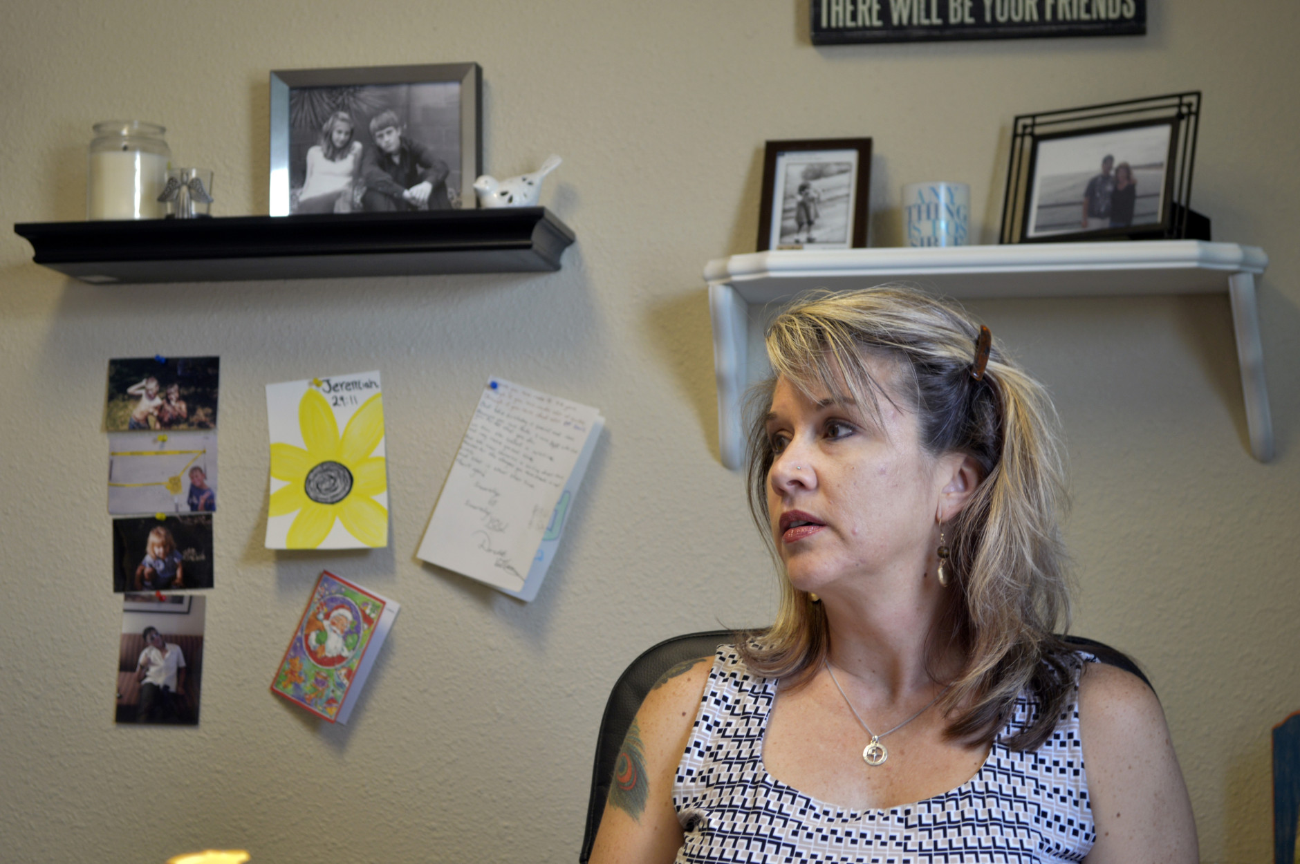 Jennifer Weiss-Burke, executive director of a youth recovery center in Albuquerque, N.M., speaks about her son on Aug. 9, 2016. She says Cameron's descent into drug addiction started with a painkiller prescription from his doctor and ended with a fatal heroin overdose nearly three years later. (AP Photo/Mary Hudetz)