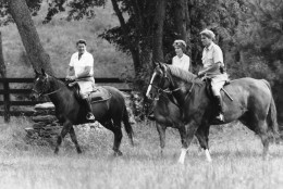 Presidential candidate Ronald Reagan, left, and Nancy Reagan are joined by Sen. John Warner, R-Va., right, in a horseback ride on the grounds of Wexford, a retreat the Reagans are renting near Middleburg, Va.  Warner and wife Elizabeth Taylor live on the neighboring farm.  (AP Photo/Walt Zeboski)