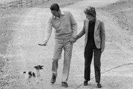 GOP Presidential candidate Ronald Reagan and wife Nancy have fun with their dog James as they take a stroll at Wexford at Middleburg, Va., on Oct. 24, 1980. Reagan took a day off from the campaign to tape a TV appearance and meet with advisors. (AP Photo/Walt Zeboski)