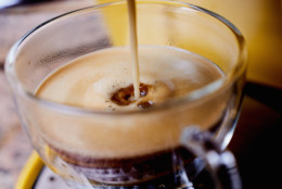 coffee cup being filled with fresh espresso coffee. Making espresso