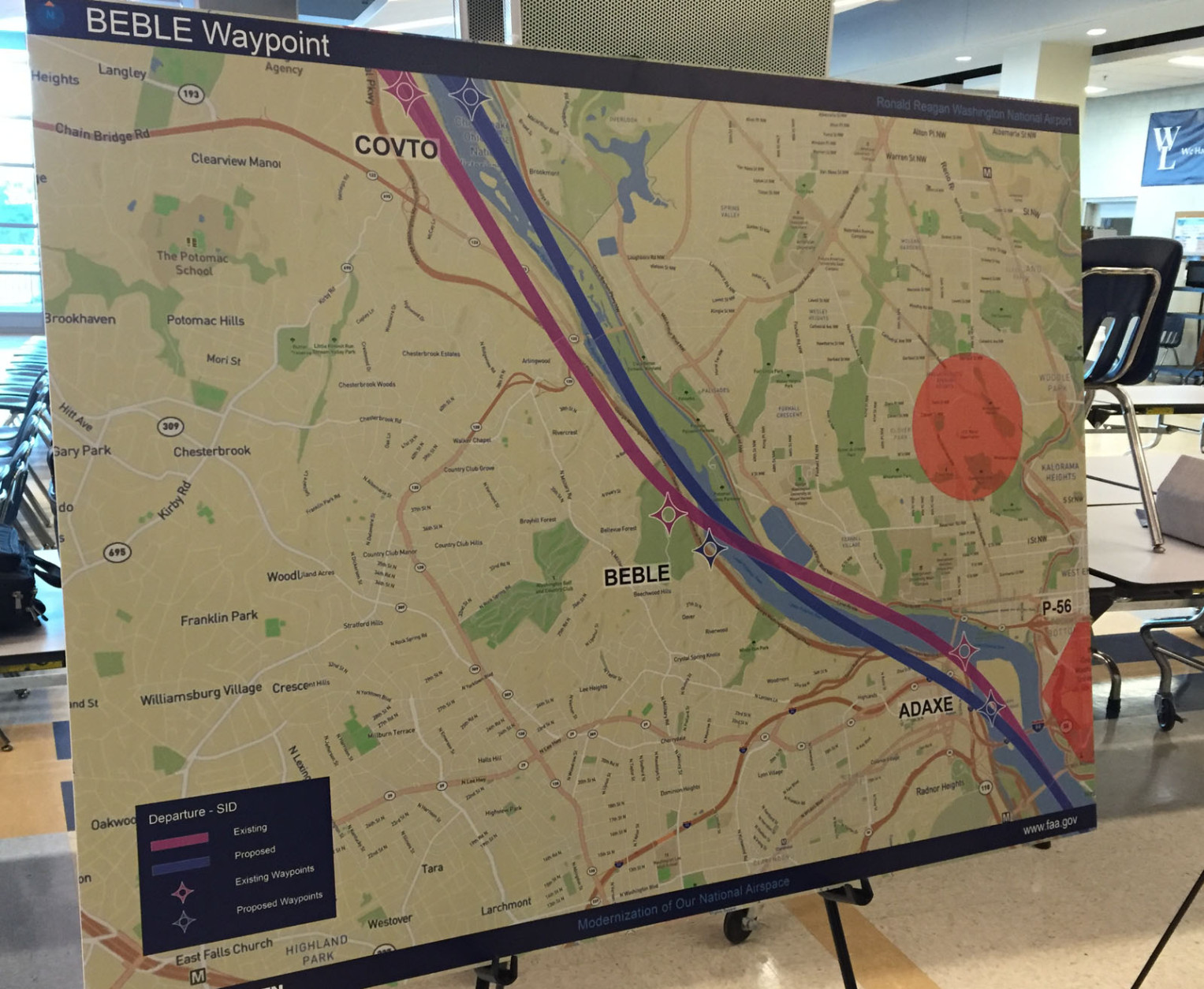 This map shows a more northern view.  Again, the purple line represents the existing flight path, and the blue line is the proposed new path.  Prohibited airspace over the National Mall and Pentagon are represented with a peach color. (WTOP/Michelle Basch)