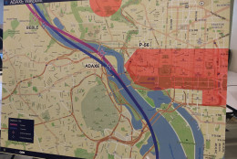 On this map, the purple line represents the existing flight path, and the blue line represents the proposed new path. The peach-colored areas highlight the prohibited airspace over the National Mall and Naval Observatory. (WTOP/Michelle Basch)