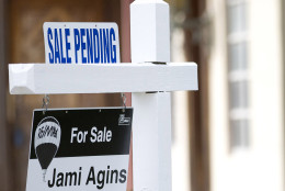 """FILE - In this Thursday, Jan. 8, 2015, file photo, a """"Sale Pending"""" sign sits atop a realty sign outside a home for sale in Surfside, Fla. The National Association of Realtors releases its March 2016 report on pending home sales on Wednesday, April 27, 2016. (AP Photo/Wilfredo Lee, File)"""