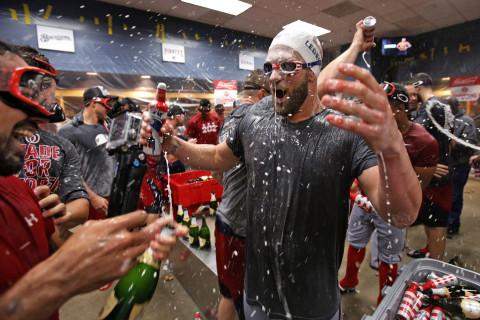 Nats' Harper wears Ledecky swim cap during NL east title win celebration