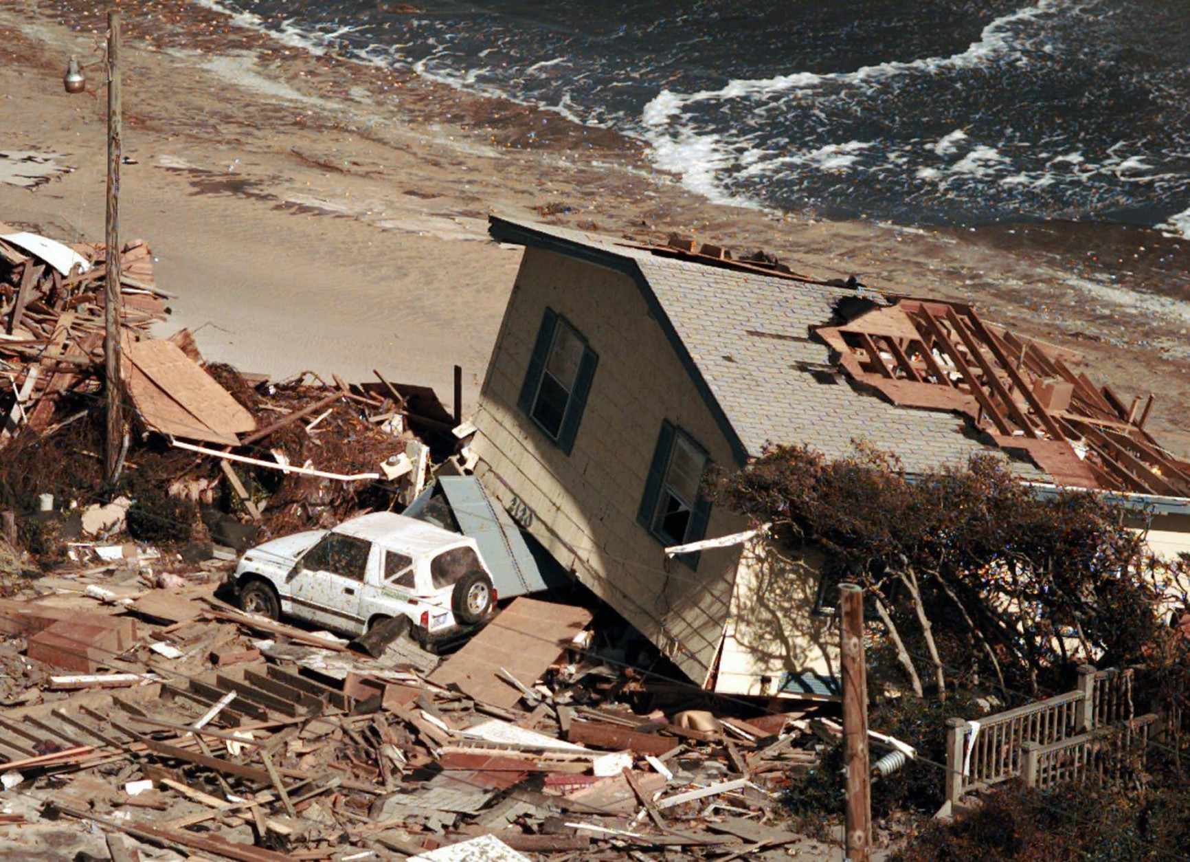 A house destroyed by Hurricane Fran is seen at North Topsail Beach, N.C., Friday, Sept. 6, 1996, after the hurricane hit the North Carolina coast Thursday night. (AP Photo/Rick Bowmer)