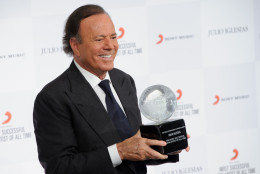 Spanish singer Julio Iglesias poses for photographers poses at a press conference with his award after being named the 'Most Successful Latin Artist of All Time',  at a central London venue, Monday, May 12, 2014. (Photo by Jonathan Short/Invision/AP)