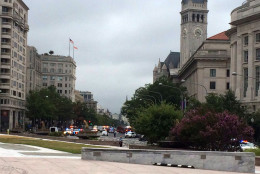 Numerous police cars fill Pennsylvania Avenue near the new Trump hotel as they investigated a suspicious package. The Warner Theatre and other nearby buildings were evacuated and entrances to the Metro Center Station were closed. Related road closures brought traffic to a near halt downtown as the morning commute was wrapping up on Tuesayd. Sept. 20, 2016. (WTOP/Nick Iannelli)