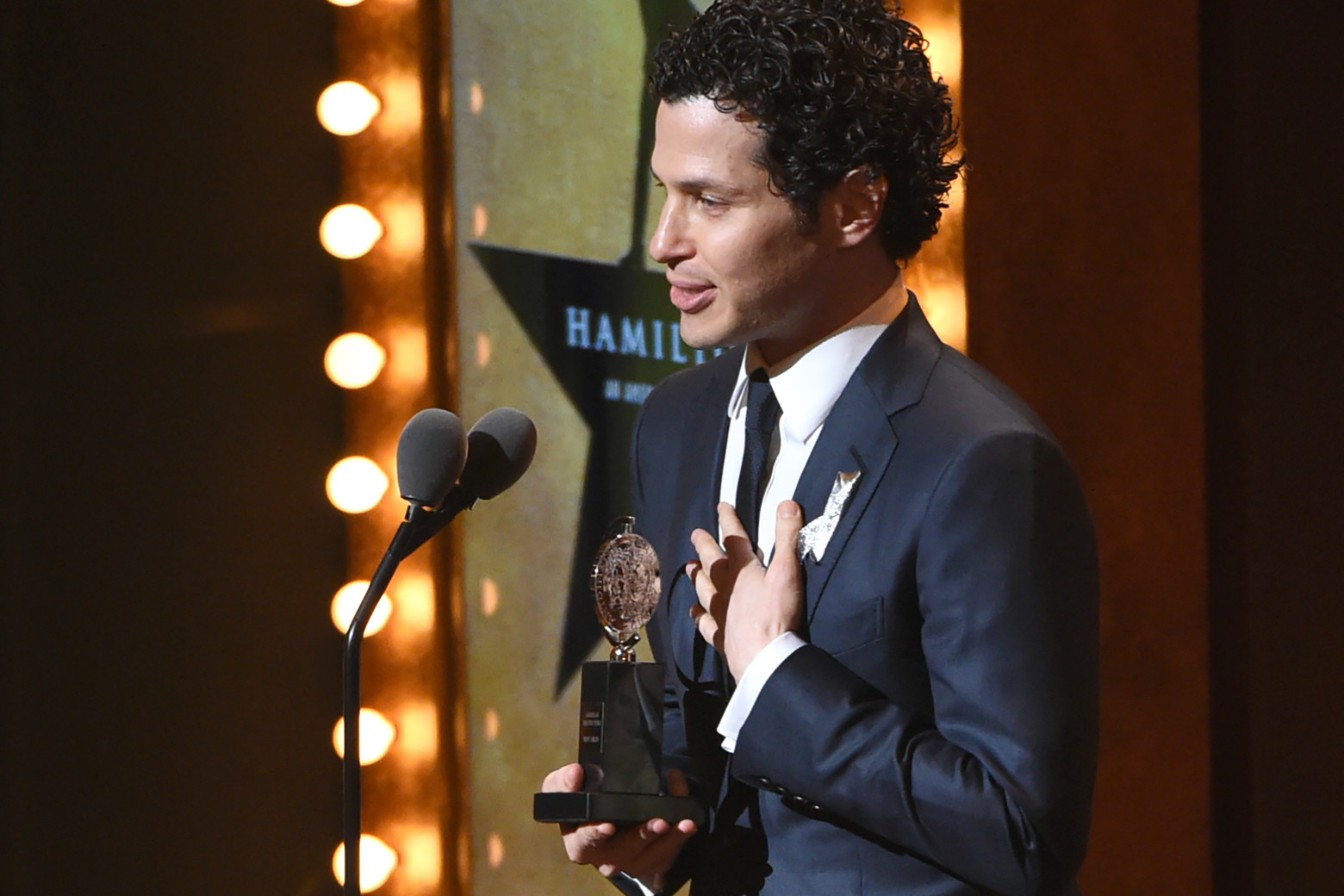 """Thomas Kail accepts the award for best direction of a musical for """"Hamilton"""" at the Tony Awards at the Beacon Theatre on Sunday, June 12, 2016, in New York. (Photo by Evan Agostini/Invision/AP)"""